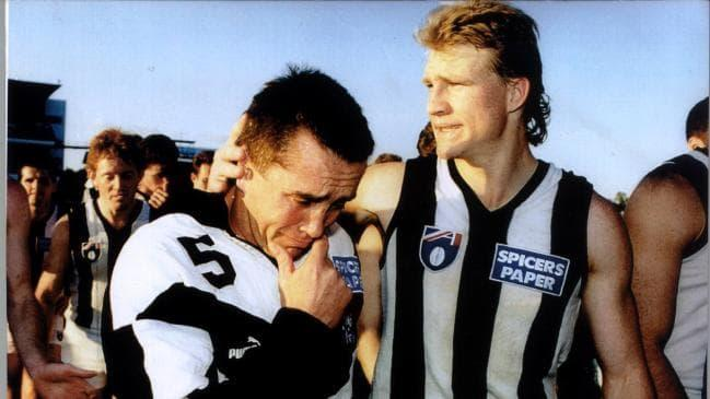Nathan Buckley comforts Collingwood's Tony Shaw following the Magpies heartbreaking loss to West Coast
