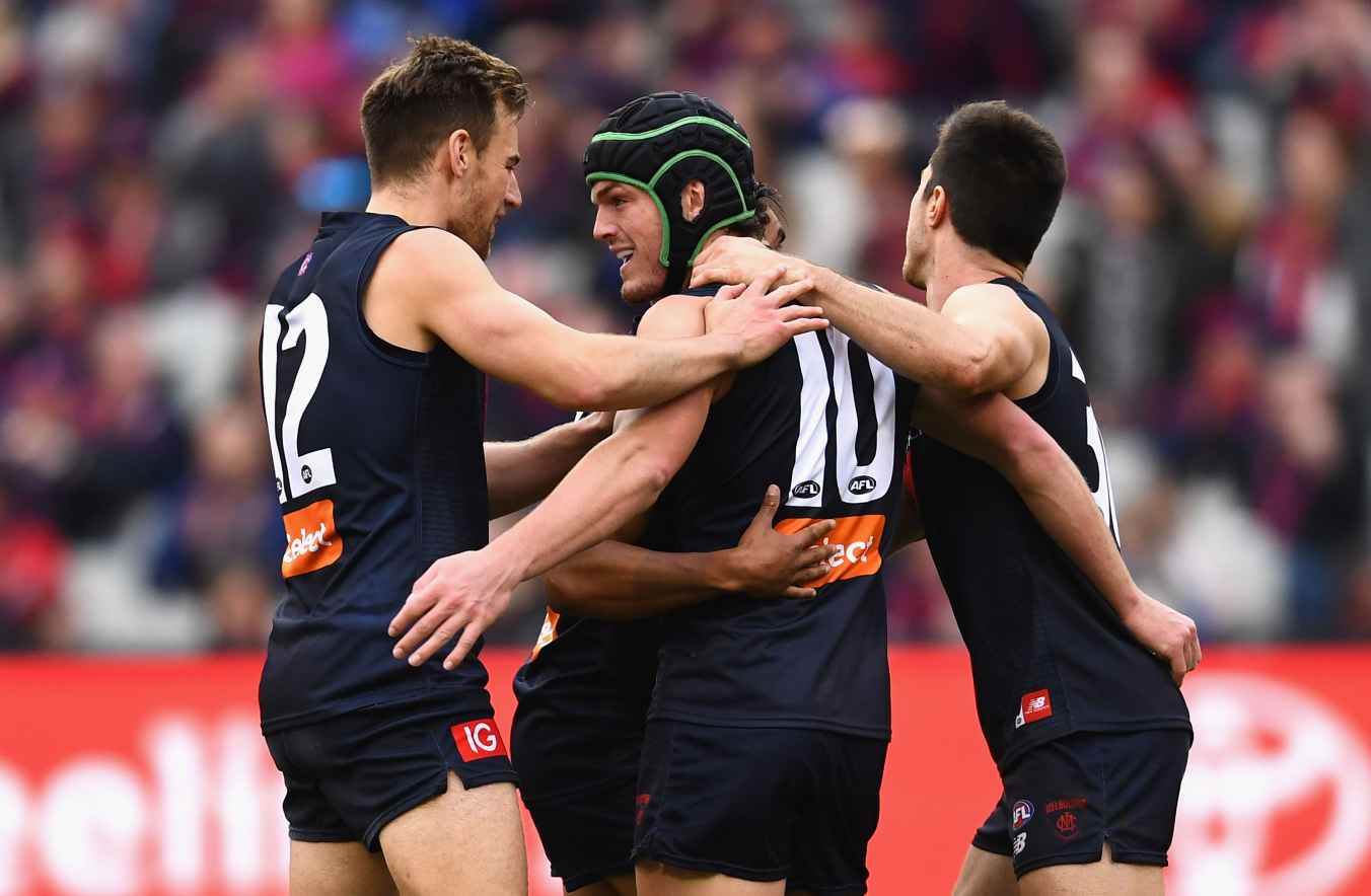 Angus Brayshaw of the Demons is congratulated by team mates after kicking a goal during the round 23 AFL match between the Melbourne Demons and the Greater Western Sydney Giants at Melbourne Cricket Ground