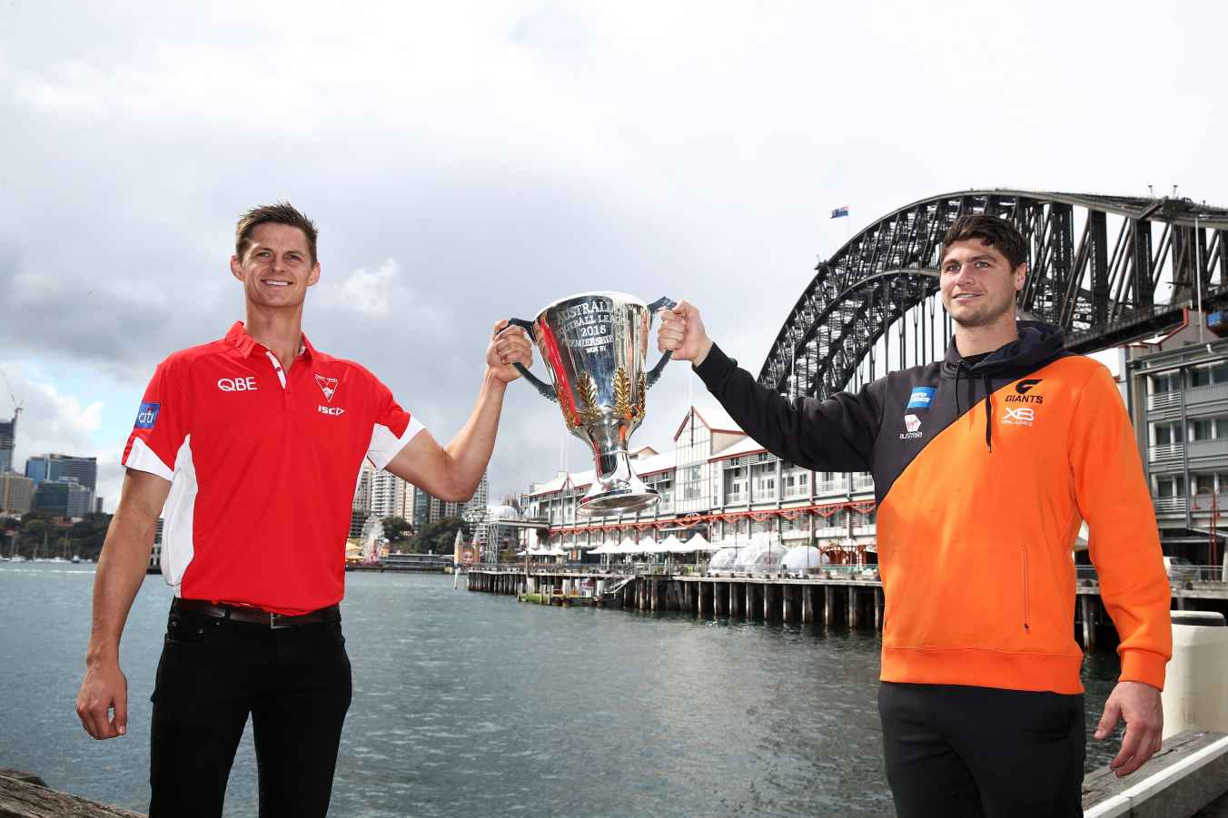 Callum Sinclair of the Sydney Swans (L) and Jonathon Patton of the GWS Giants (R) pose with the AFL Premiership Cup during the 2018 Toyota AFL Finals Series in Sydney Media Event