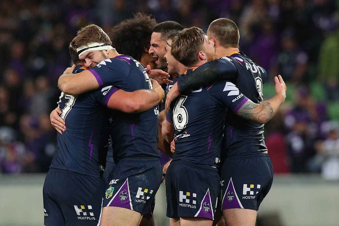 The Storm players celebrate victory in the NRL Qualifying Final match between the Melbourne Storm and the South Sydney Rabbitohs at AAMI Park on September 7, 2018 in Melbourne, Australia.