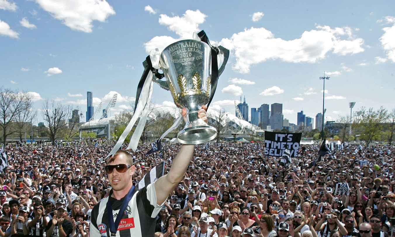 Magpies captain Nick Maxwell holds the Premiership Cup aloft during the Collingwood Magpies AFL Grand Final reception at Gosch's Park on October 3, 2010