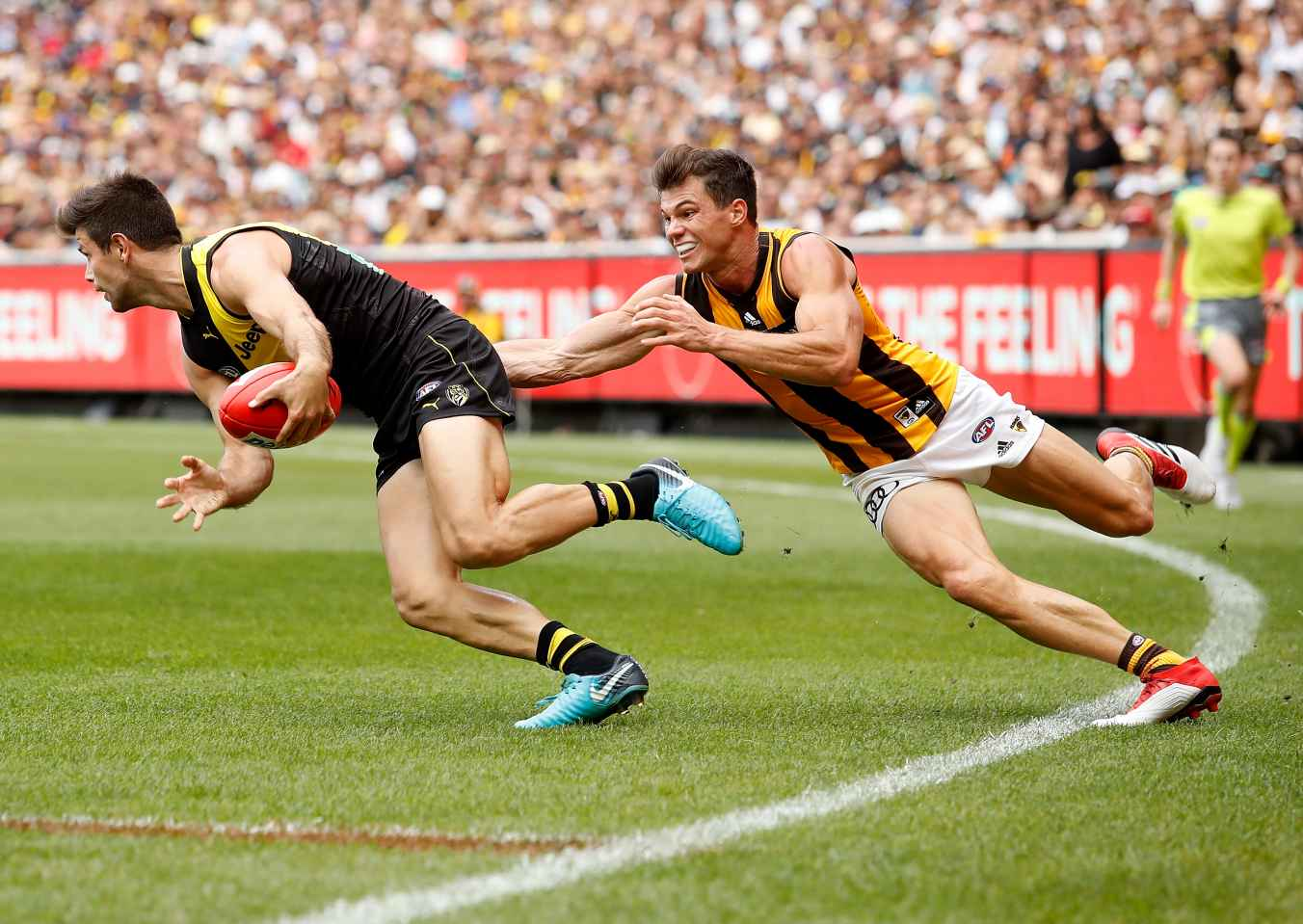 Trent Cotchin of the Tigers is tackled by Jaeger OâMeara of the Hawks during the 2018 AFL round 03 match between the Richmond Tigers and the Hawthorn Hawks at the Melbourne Cricket Ground