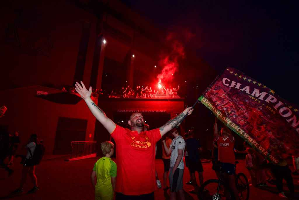 A fan celebrate Liverpool's Premier League title win at Anfield
