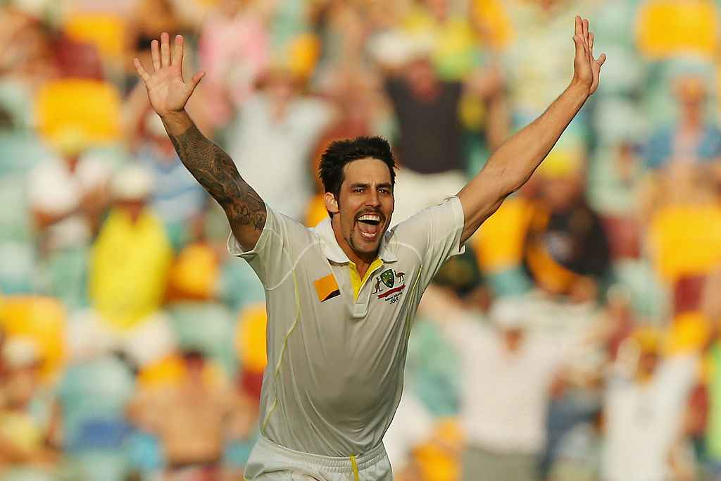 Mitchell Johnson celebrates a wicket during the first Ashes Test in 2013