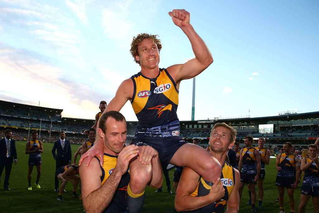 Matt Priddis is carried off at Subiaco after West Coast defeated Adelaide to just make the 2017 AFL Finals