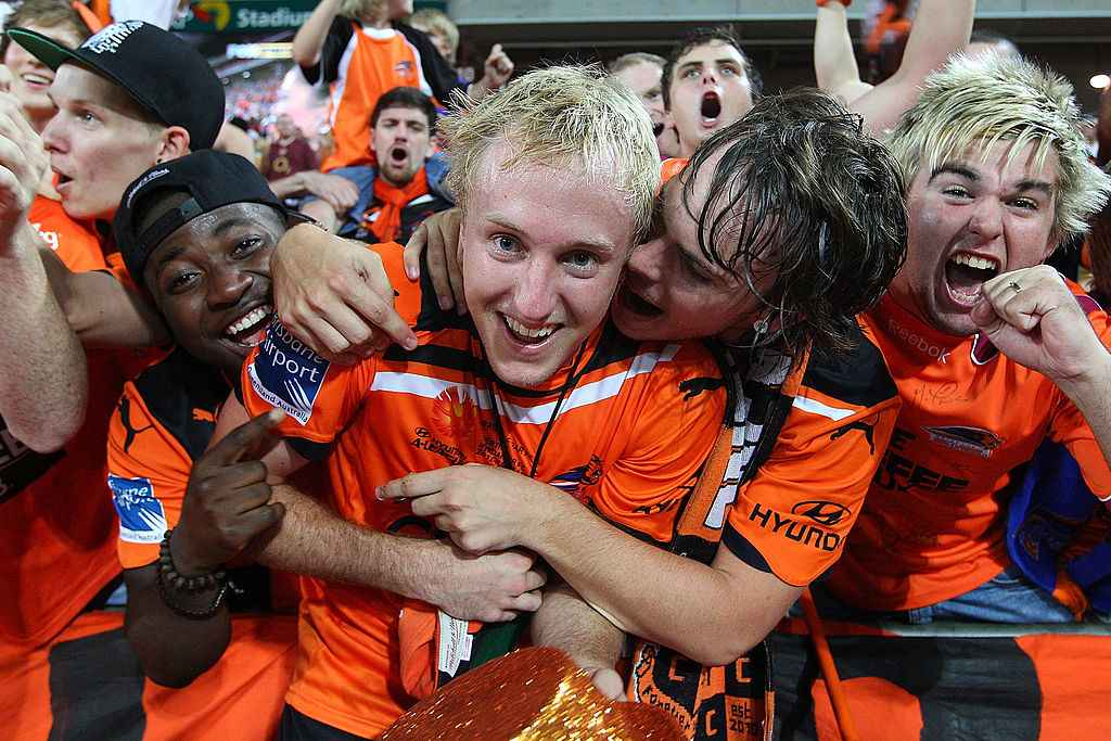Mitch Nichols of the Roar celebrates with fans after winning the 2012 A-League Grand Final match between the Brisbane Roar and the Perth Glory at Suncorp Stadium