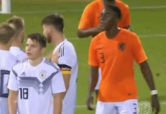 Dutch footballer suspended for spitting on German opponent