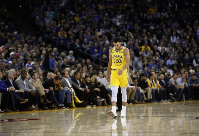 NBA Wrap: Stephen Curry injured as Bucks maul Warriors