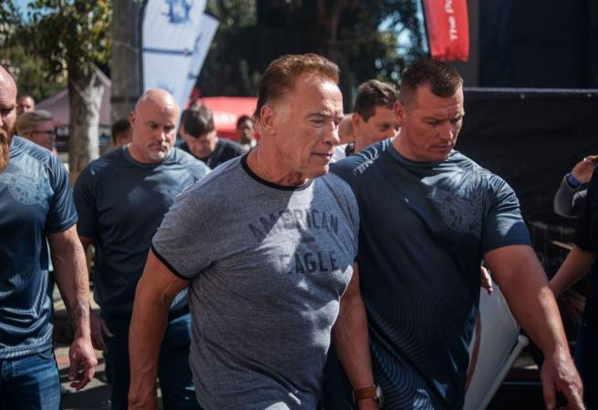 WATCH: Man drop-kicks Arnold Schwarzenegger but fails miserably