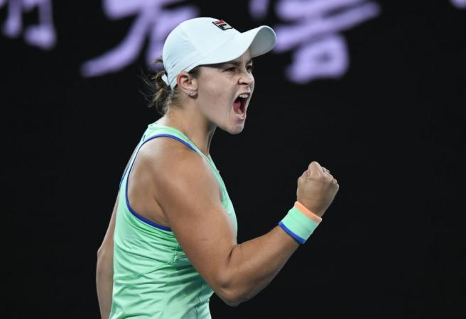 Ash Barty survives challenge to progress to quarters