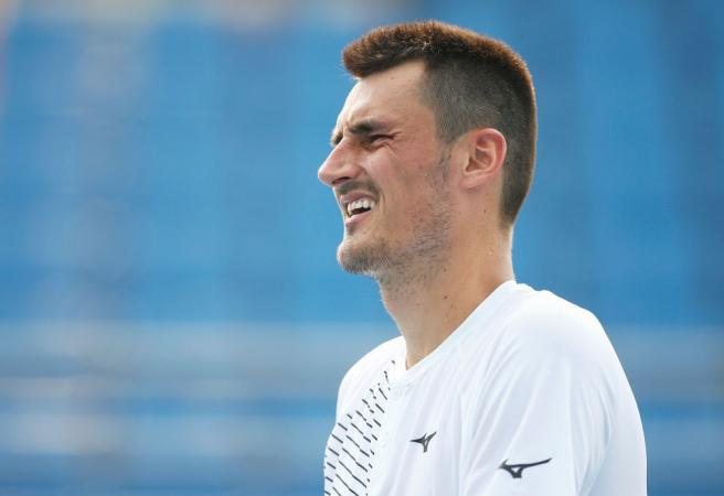 Bernard Tomic loses match in just 39 minutes