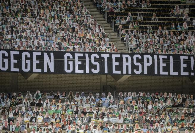 Bundesliga team fills stadium with cardboard cutouts of fans with all proceeds going to charity
