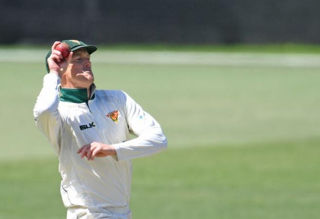 George Bailey bowls in Tassie cap in his final match