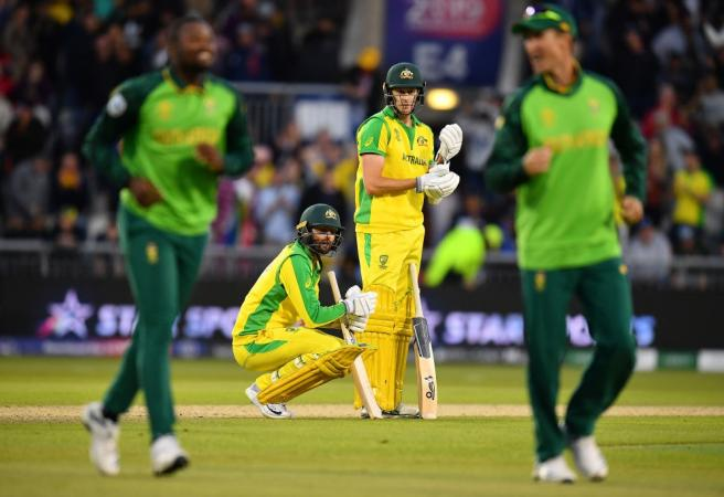 Warner and Carey heroics not enough as Aussies go down to South Africa