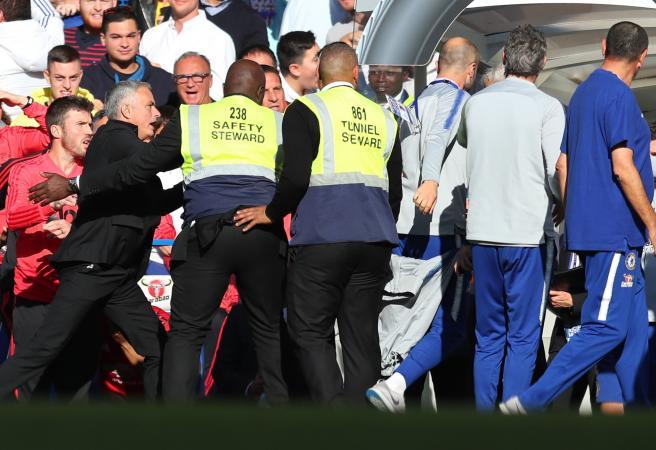 Mourinho restrained as all hell breaks loose in Chelsea vs Man U clash