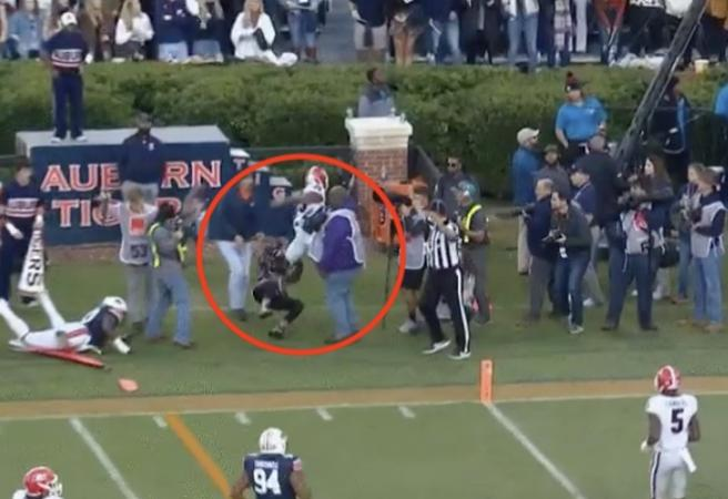WATCH: Photographer knocked out after nasty sideline collision