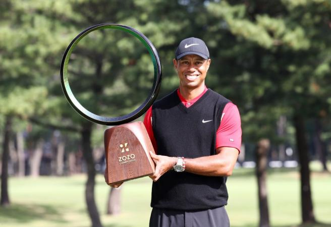 Tiger Woods wins 82nd PGA Tour event
