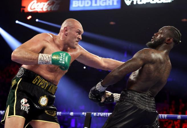 Tyson Fury scores incredible TKO victory over Deontay Wilder