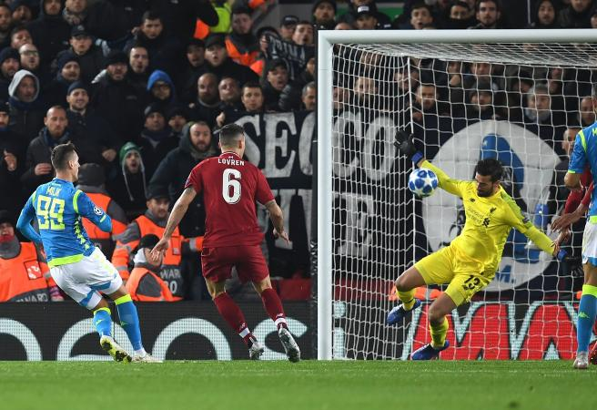 Alisson's brilliance helps guide Liverpool to crucial win