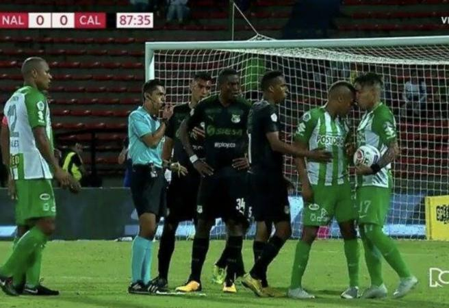 WATCH: Colombian footballer headbutts teammate