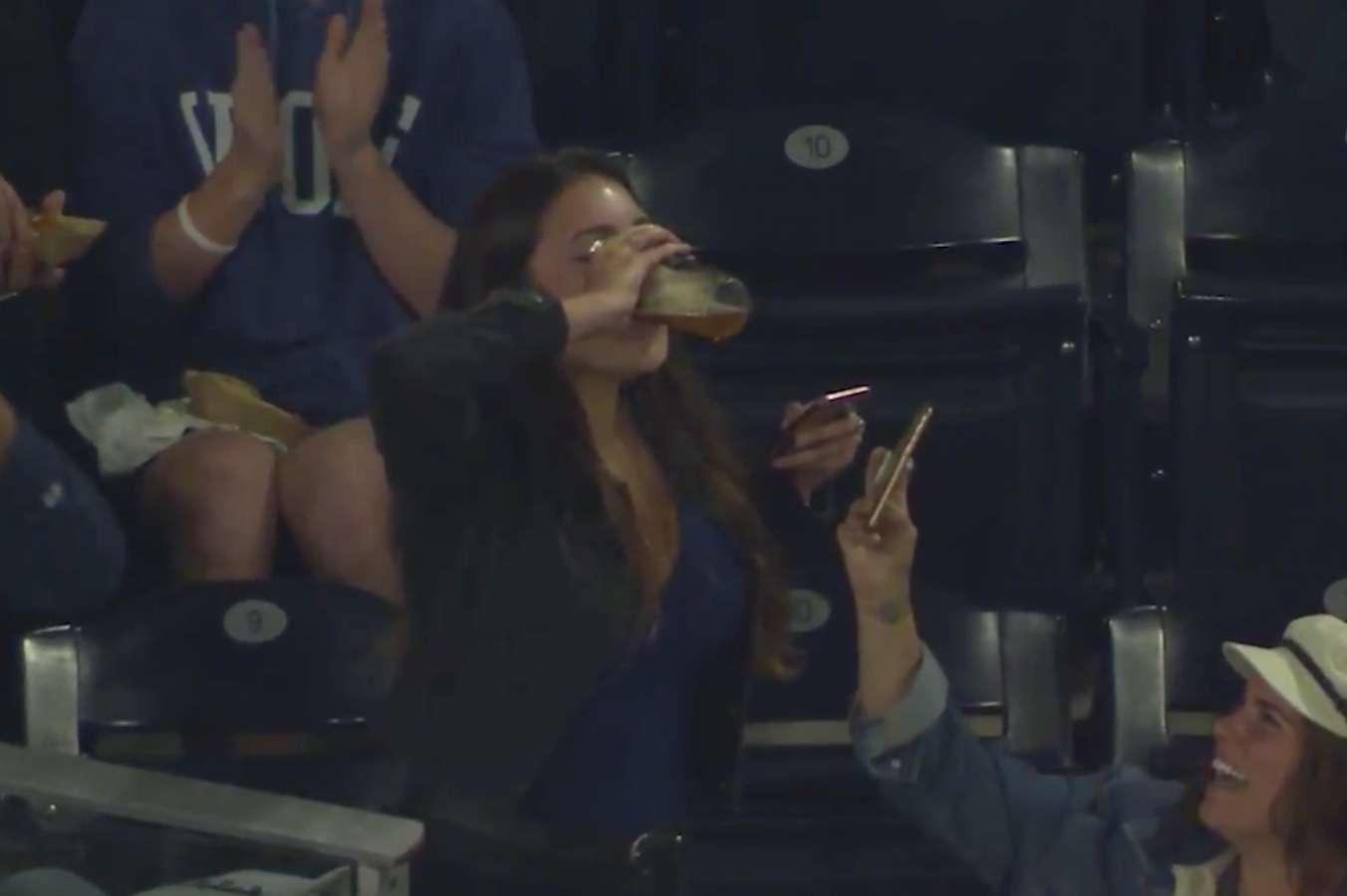 WATCH: Woman catches foul ball then skolls beer