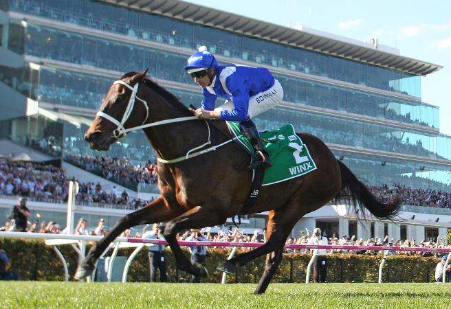 Winx roars home to capture 28th straight win in Turnbull Stakes