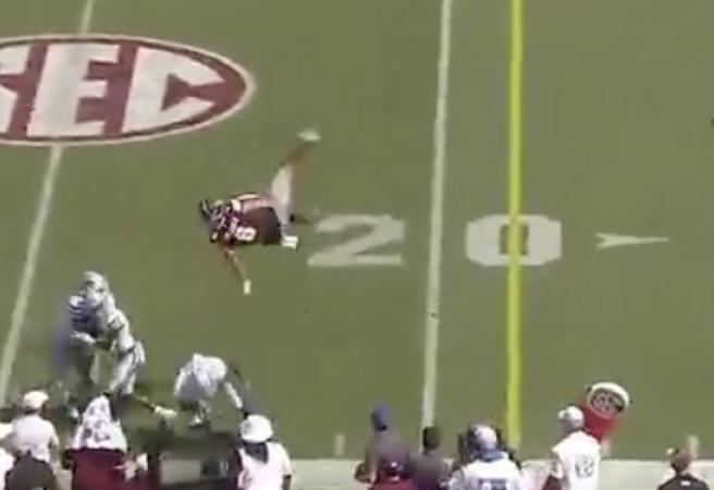 WATCH: Quarterback does mid-air 360 after getting hit